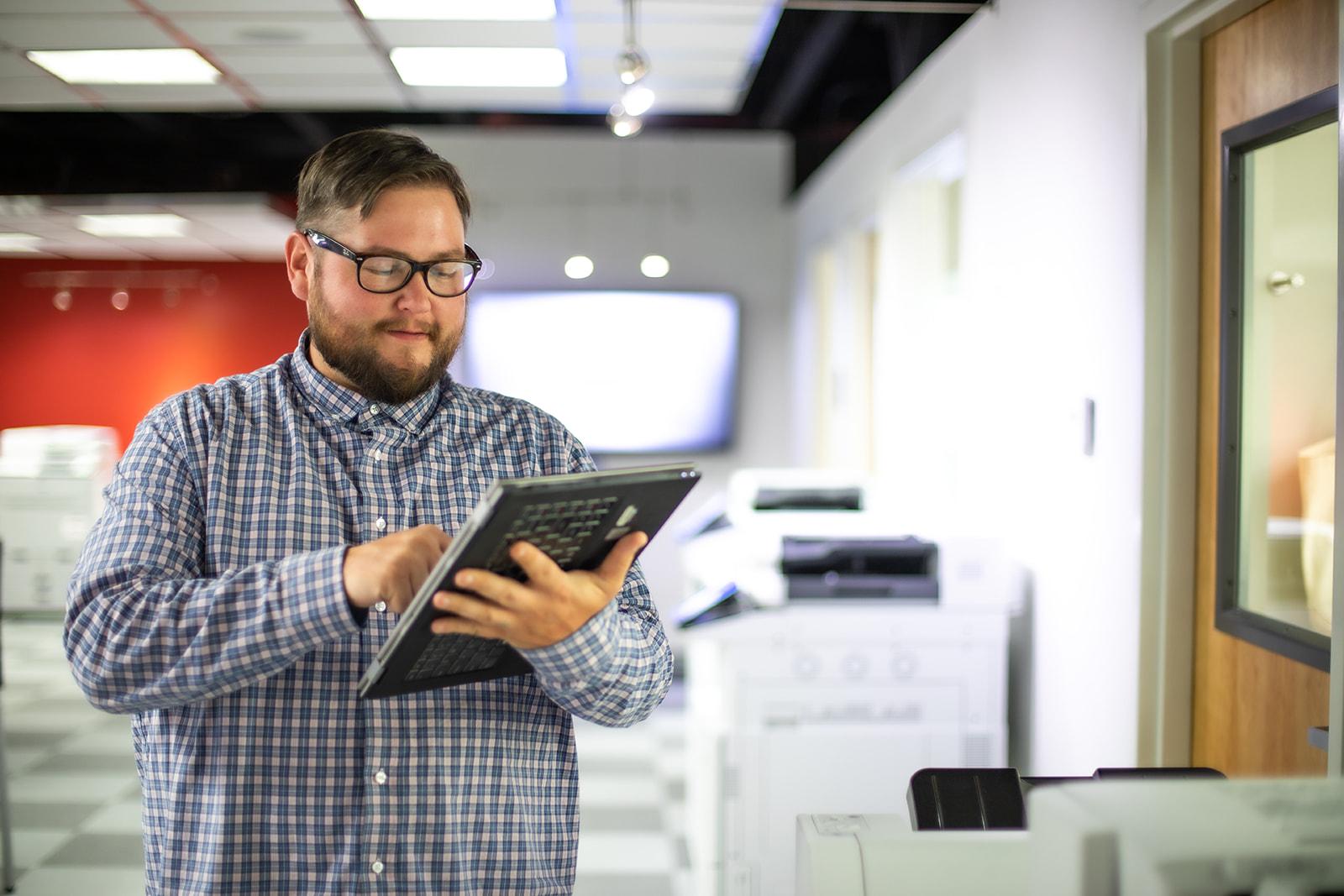a guy looking at his ipad